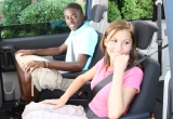 Two teenage children in a vehicle.