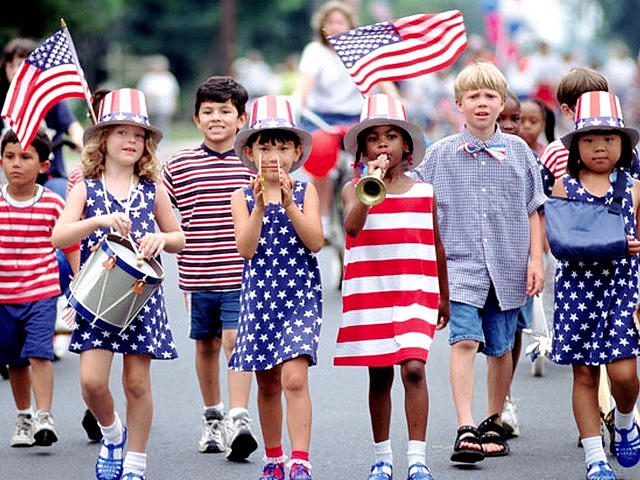Photo of kids marching in a 4th of July parade