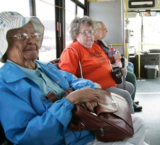 Photo of seniors aboard a transit bus