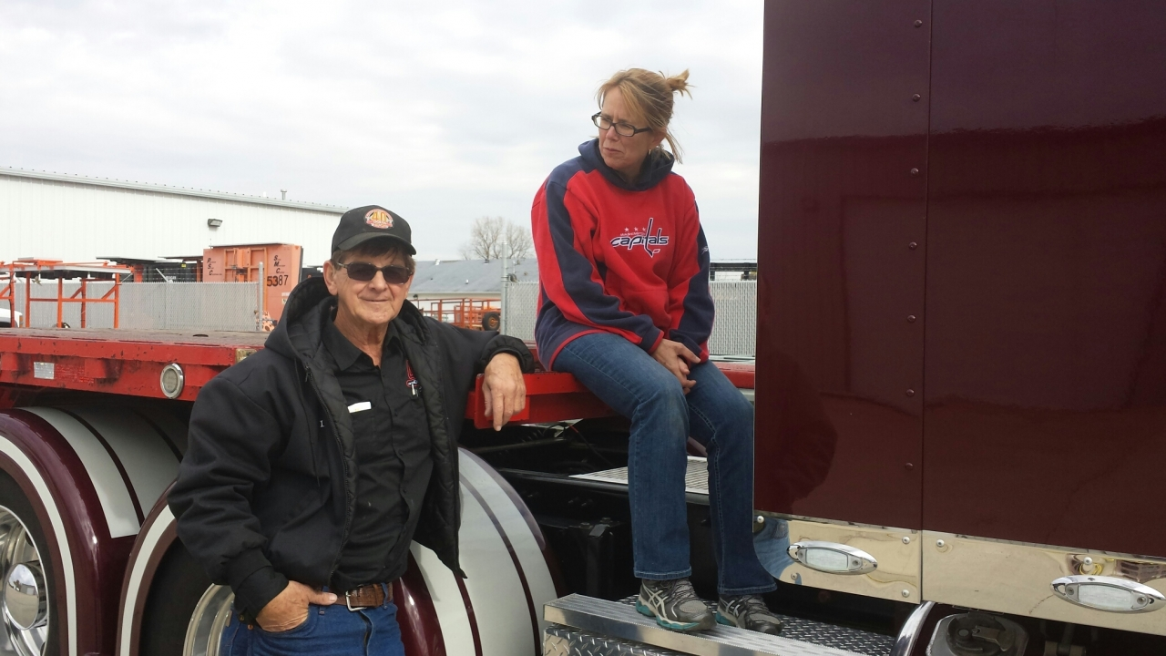Photo of Anne Ferro with truck driver Leo Wilkins