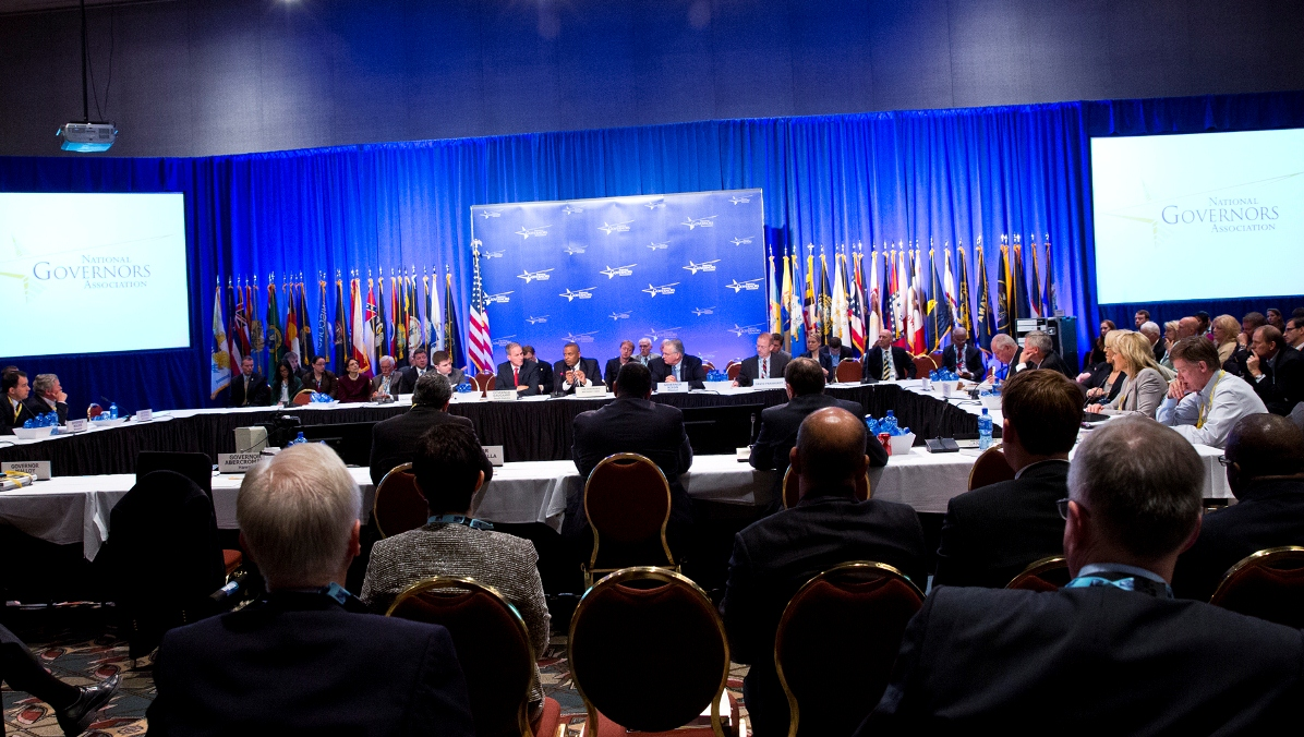 Wide photo of the Joint Session with governors and Secretary Foxx seated around a large table