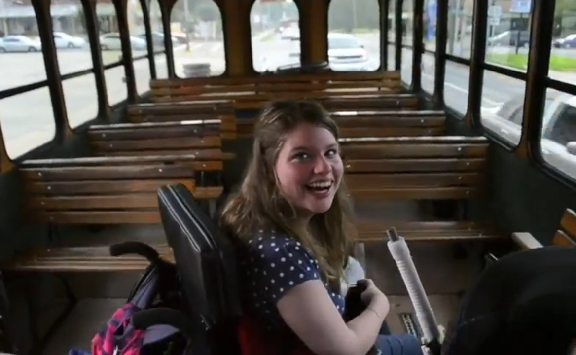 Photo of student in wheelchair on streetcar