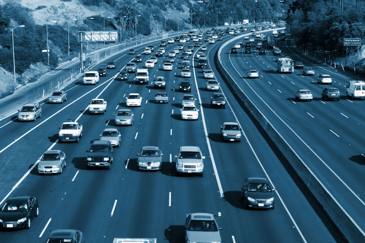Blue-washed photo of a busy California highway