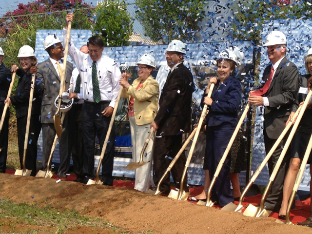 Photo of participants at LYNX Blue Line light rail extension groundbreaking, including FTA Administrator Peter Rogoff, with shovels in hand and confetti in the air