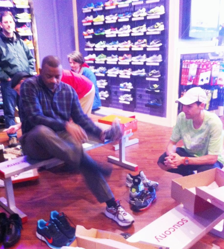 Photo of Secretary Foxx trying on running shoes