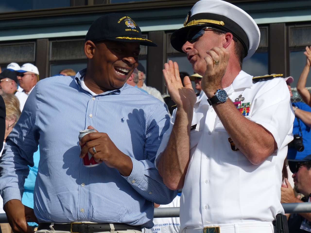Photo of Secretary Foxx cheering on the mariners with RADM Helis