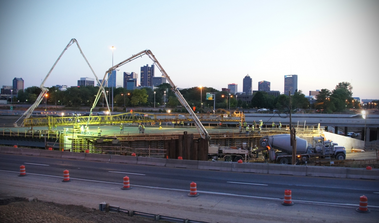 Photo of workers doing a concrete pour at night onthe Columbus Crossroads Porject. Photo courtesy Ohio D.O.T.