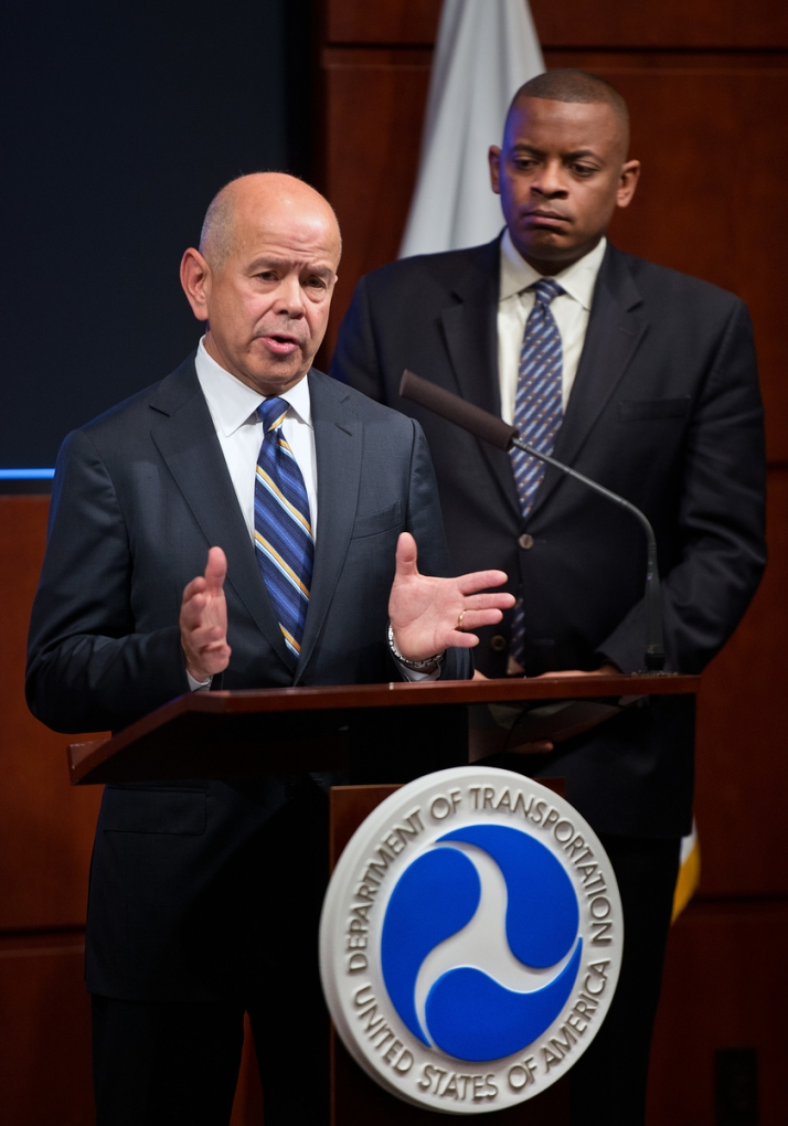 Photo of Michael Huerta at press conferene announcing the new F.A.A. rule. Secretary Foxx stands behind Huerta.