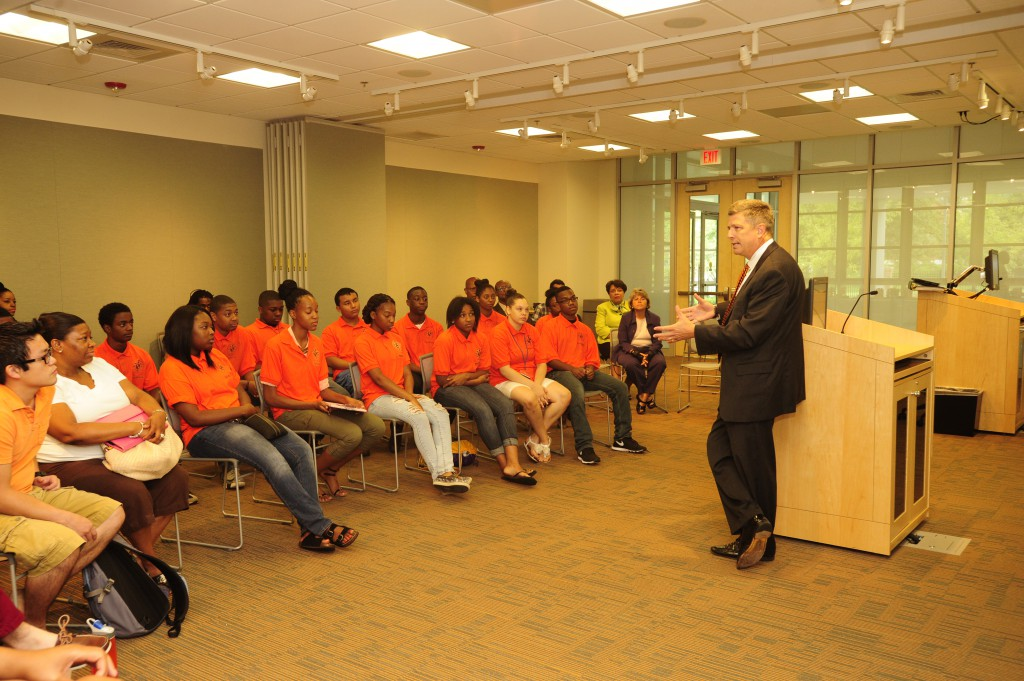 Photo of Deputy Secretary Procari speaking to students in a Morgan State university classroom