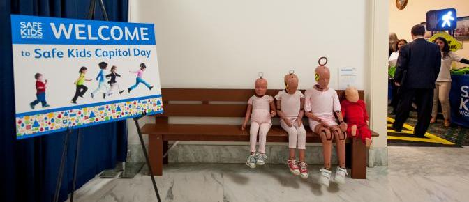 Photo of crash test dummies seated on a bench