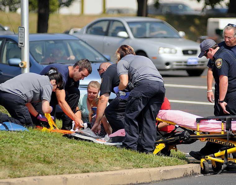 Photo of EMS technicians on the scene of a crash