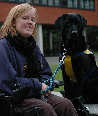 Photo of student with seeing eye dog.
