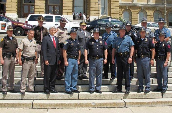 Photo of law enforcement representatives from the 11 I-80 states