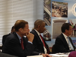 Photo of Secretary Foxx listening to local stakeholders at a roundtable discussion in New Haven