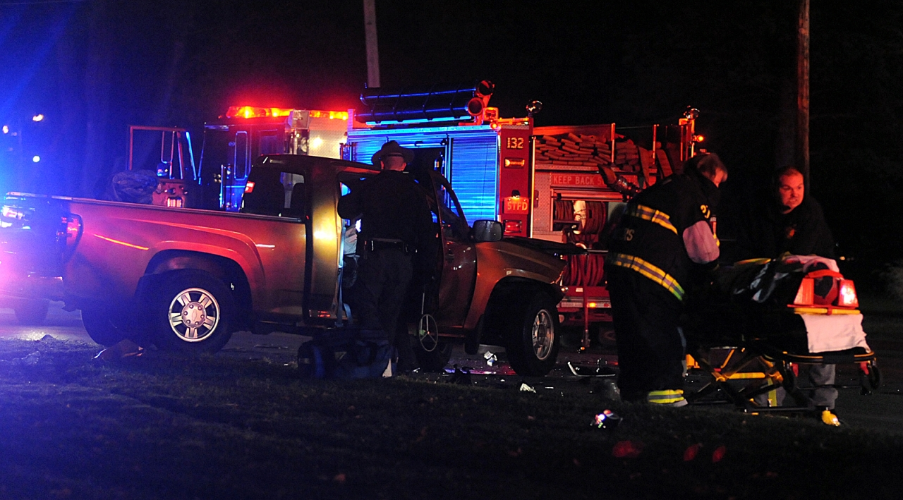 Photo of EMS responders on the scene of a night-time crash