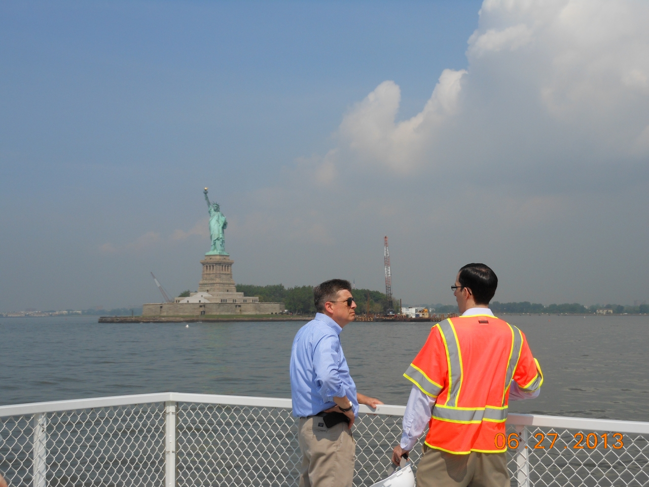 Photo of Deputy Secretary Porcari on vessel approaching Liberty Island