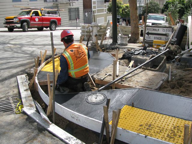 Photo of workers installing A.D.A. compliant curb cuts in San Francisco