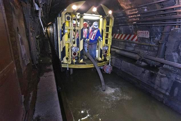 Photo of transit workers pumping out a New York subway train