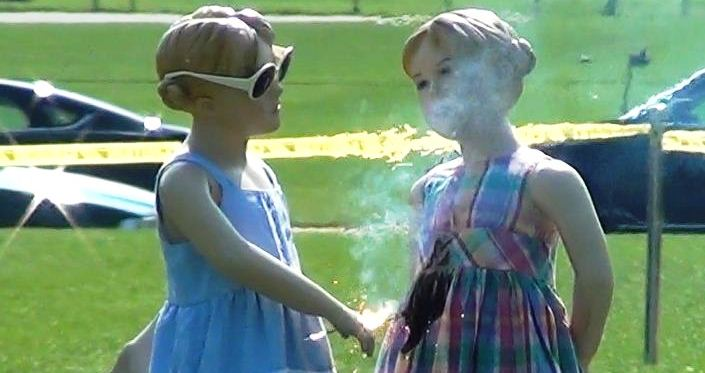 Photograph of dummies demonstrating improper sparkler safety
