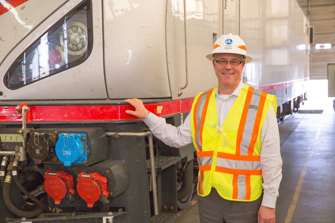 Photo of F.R.A. Administrator Szabo standing near Cities Sprinter locomotive at the T.T.C.