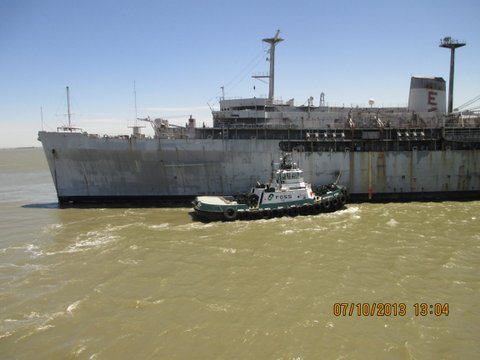 Photo of U.S.S. Holland being towed from Suisun Bay by a Foss tugboat