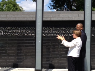 Photo of Senator Klobuchar showing Secretary Foxx the memorial to lives lost in the 2007 collapse of the I-35 W Bridge