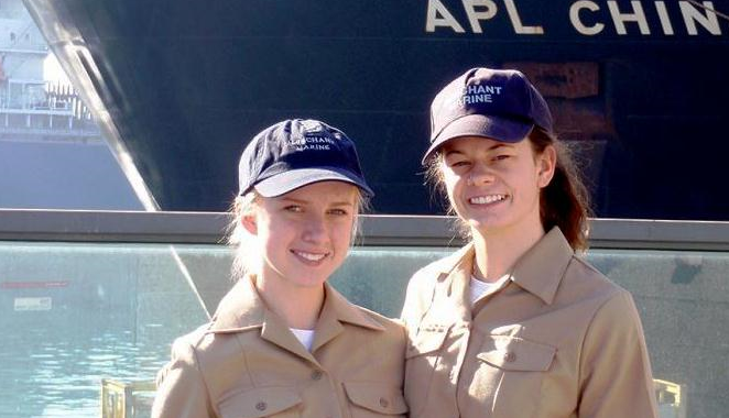 Photo of two women mariners in front of ship