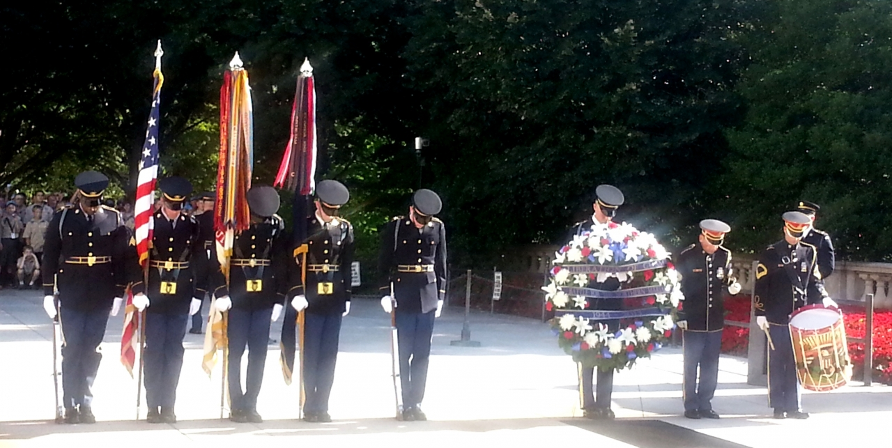 Photo of wreath-laying ceremony with color guard