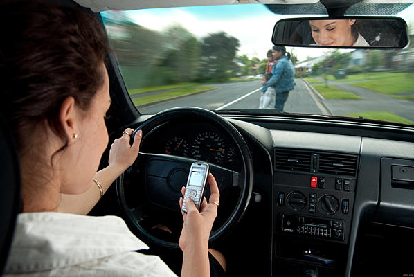 Photo of texting driver