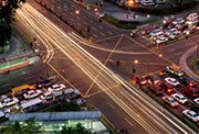 Four way traffic stop depicting adaptive signal contol with streaks light from moving traffic.
