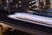 Fast-moving train blurred in image.