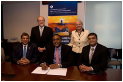 (Seated L-R) Shiv Krishnan, President and CEO of INDUS Corp.; Brandon Neal, Director OSDBU; Sandesh Sharda, President, Miracle Systems, Inc. (Standing L-R) Michael Bowers, Chief Operating Officer, INDUS Corp. and Paula Ewen, Senior Vice President, Homeland Security and Civilian Sector, INDUS Corp.