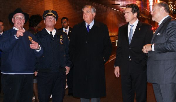 Photo of Secretary LaHood examining tunnel damage with N.Y. Governor Cuomo