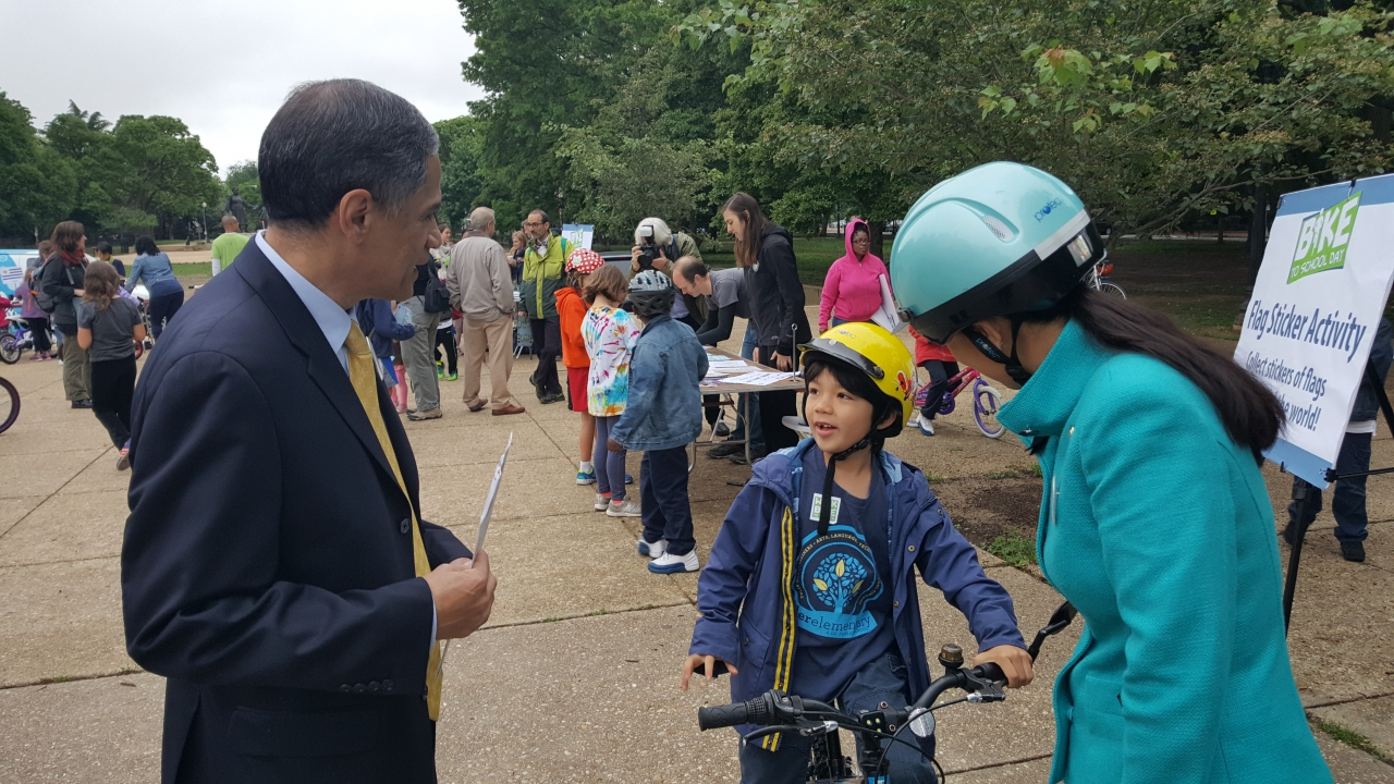 Victor Mendez talking to boy on bike image