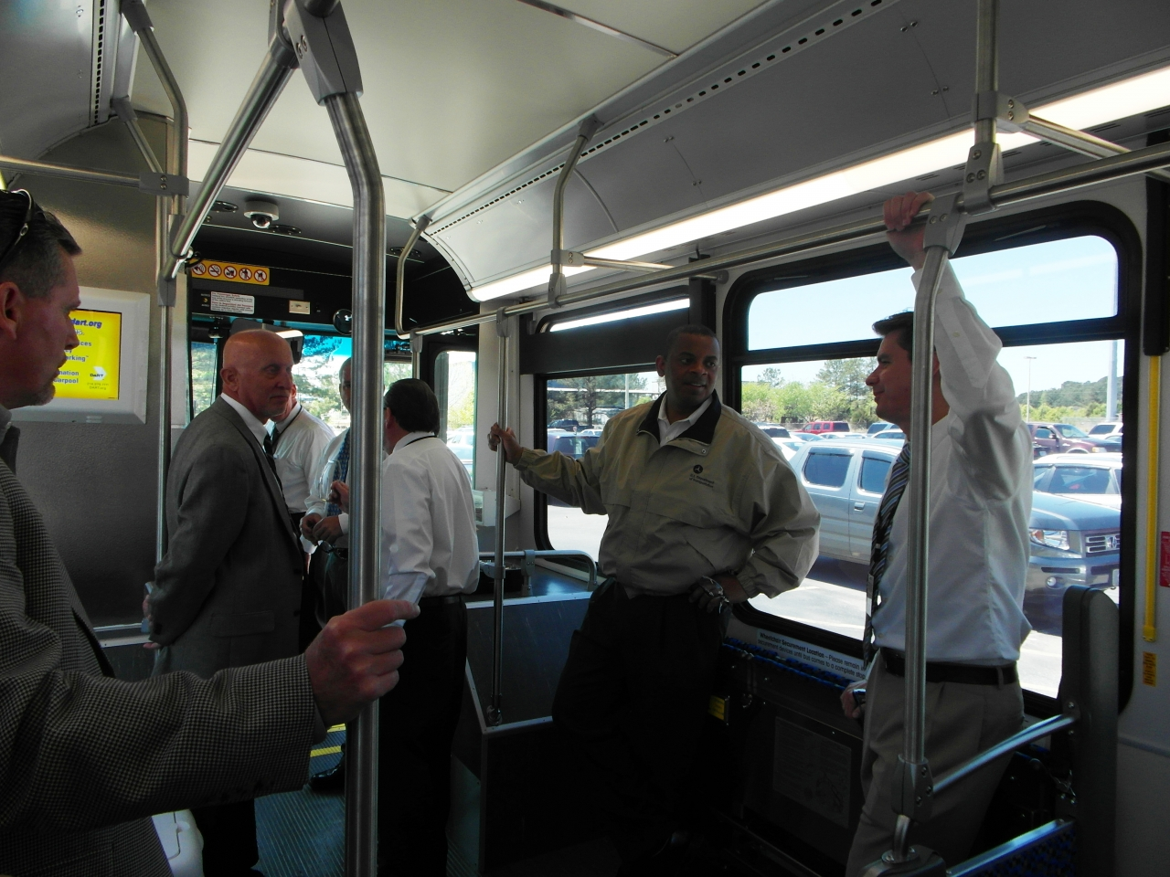 Photo of Secretary Foxx riding on a NABI bus