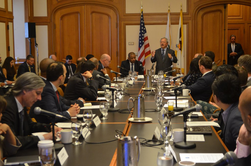 Image of Secretary Anthony Foxx and representatives at the conference table