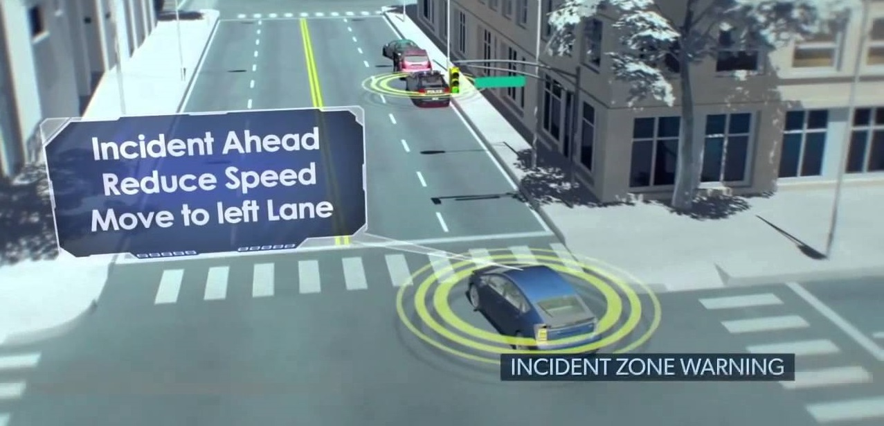 "virtual image of road with text ""Incident Ahead Reduce Speed move to left lane"""