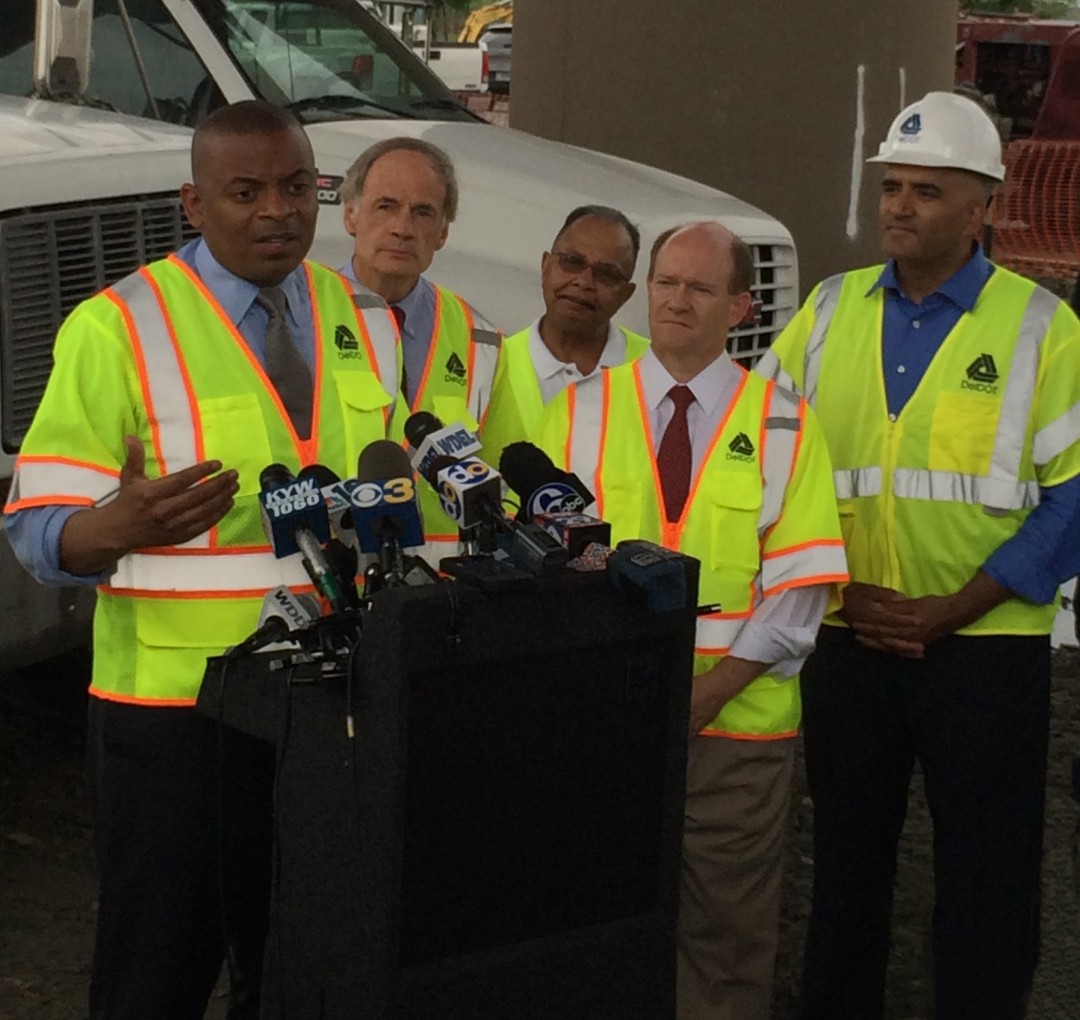 Photo of Secretary Fox and others at I-495 bridge near Wilmington, Delaware
