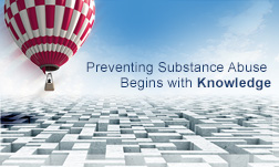 "A red and white checkered hot-air balloon is rising up toward the right, above a complex maze below. A slogan to the right of the balloon says, ""Preventing Substance Abuse Begins with Knowledge."""