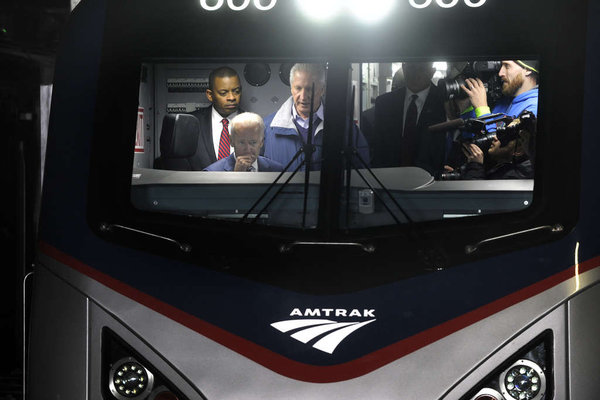 Photo of V.P. Biden and Secretary Foxx in the cab of the new Amtrak locomotive; photo courtesy Phildelphia Inquirer, Tom Gralish