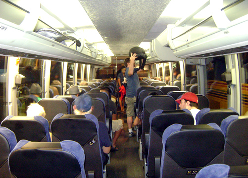 Photo of young travelers aboard a motorcoach