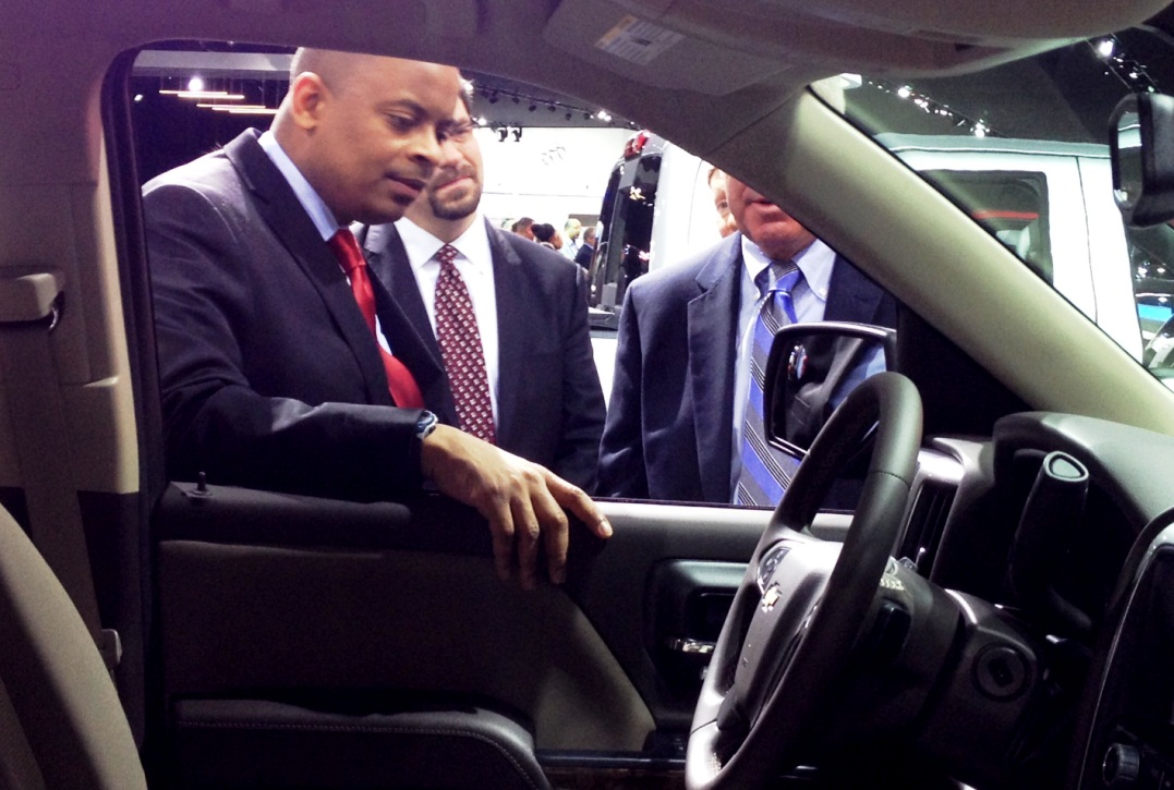 Photo of Secretary Foxx looking in the cab of a Chevy Silverado