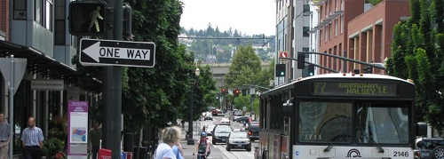 image of a street with cars and directional signage