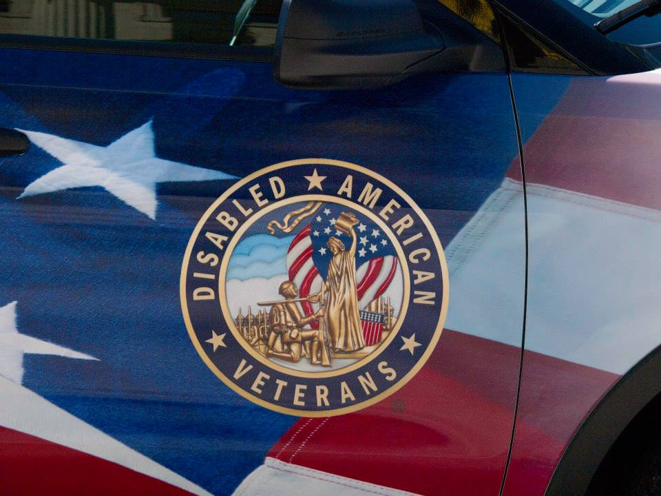 Phot of a flag displaying a logo for Disabled American Veterans