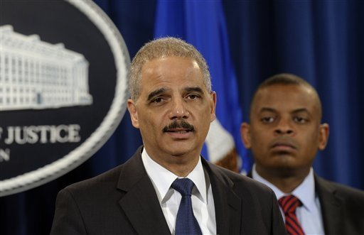 Photo of Secretary Foxx and Attorney General Holder, credit Susan Walsh, AP