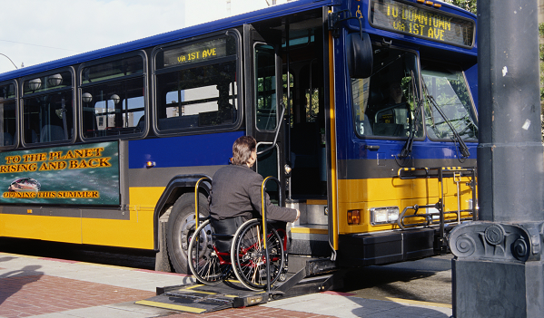 Man in wheelchair boarding a tranist bus