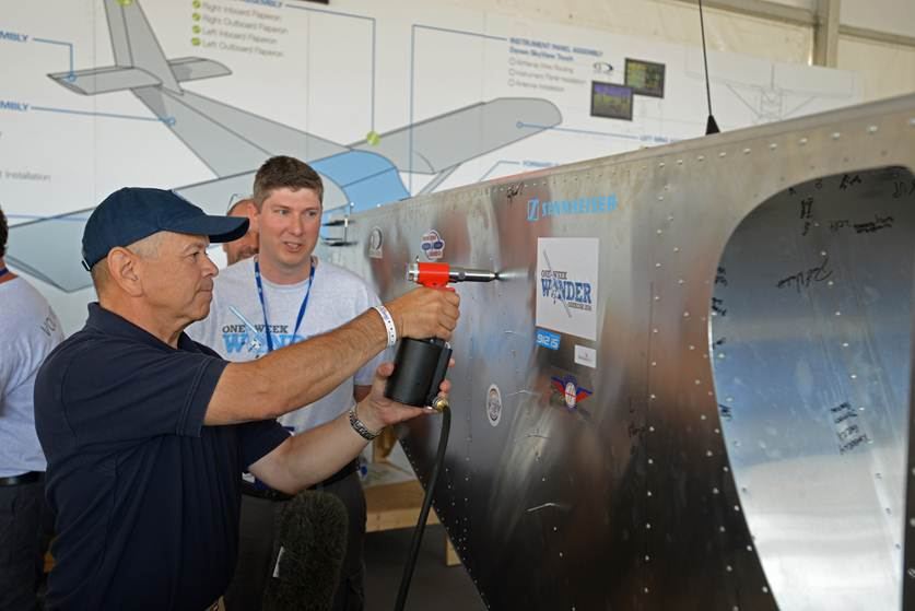 Photo of FAA Administrator making his contribution to the One Week Wonder at Oshkosh