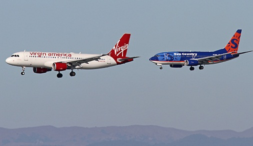 Photo of two airliners landing on parallel runways
