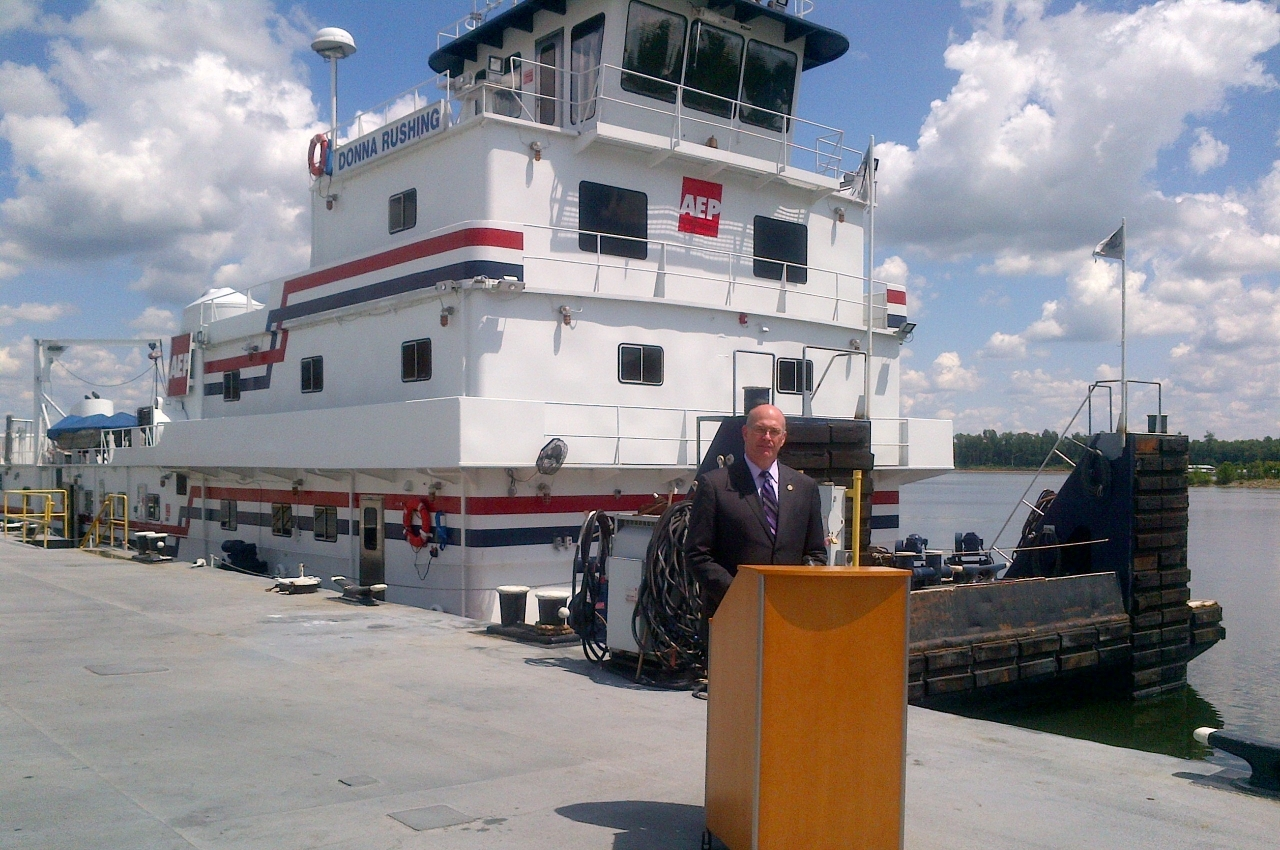 Photo of Chip Jaenichen speaking with the M/V Donna Rushing in the background