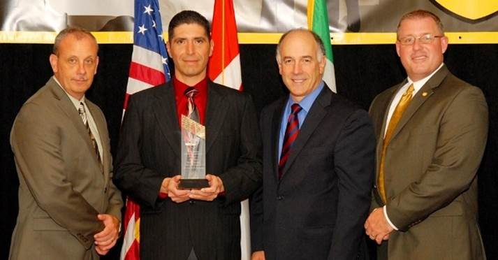 NAIC Jimmy K. Ammons Grand Champion award winner, JW Watlington.  Mr.Watlington, of the Arizona Department of Public Safety